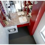 Стиральная машина в интерьере ванной комнаты